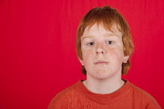 Red-headed teenage boy with grim expression Stock Photo