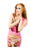 Red-headed woman in pink dress. Pretty red-headed woman in pink dress on white royalty free stock image