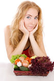 Red-headed woman with vegetables. Over white background Stock Photo