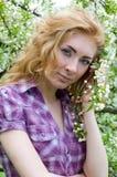 Red-headed womn under cherry tree royalty free stock photos
