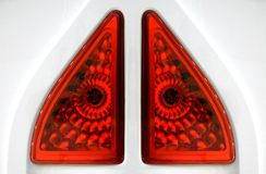 Red headlamp or backlight. Of white vehicle consisting of elements of a triangular shape stock photography