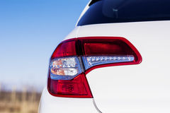Red Headlamp on a modern white  car Stock Photography