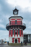 Red headlight house with clock Stock Photo