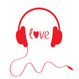 Red headphones with cord . Isolated. Love card. Stock Photo
