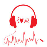 Red headphones with cord  in shape of cardiogram.  Stock Image