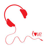 Red headphones with cord . White background. Love  Royalty Free Stock Photos