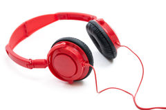 Red Headphones. Isolated on a white background royalty free stock photos