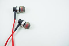 Red headphones lay on a white background. Red headphones lay on a white background in isolated object Royalty Free Stock Photo