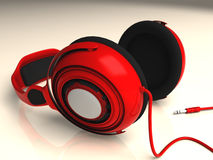 Red Headphones Low Left DOF. Red headphones isolated on white Royalty Free Stock Photo