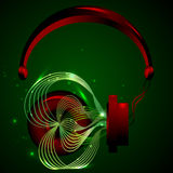 Red headphones with music. Music comes out of the headphones and included in them the same. Red and green headphone music Stock Image