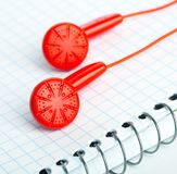 Red headphones on notebook Royalty Free Stock Photography
