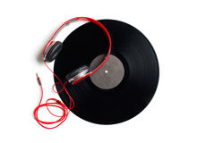 Red headphones with vinyl album Royalty Free Stock Photography
