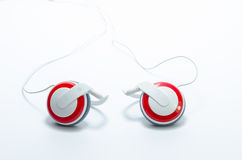 Red headphones on white background Royalty Free Stock Photo