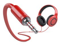 Red headphones with wire and 3.5 mm jack plug. 3d illustration isolated over white background Royalty Free Stock Photo