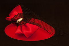 Red Headwear  with Bow and Black Lace. Red headwear with black lace and bow displayed on background Royalty Free Stock Photo