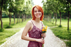 Red Heair Woman Holding Spring Flowers Royalty Free Stock Photography
