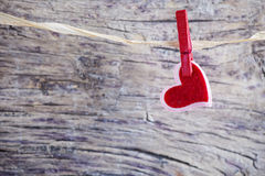 Red hearst. Beautiful single red heart janging over blurred background Stock Images