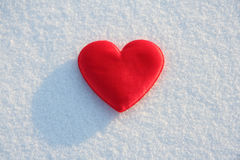 Red heart. Red silk heart on the snow Royalty Free Stock Photography