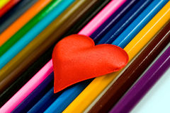 Red heart. On multi-coloured background Royalty Free Stock Photo