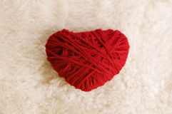 Red heart. Woolen red heart shape on fur background Royalty Free Stock Photography