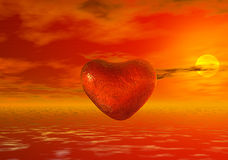 A red heart. A heart symbol of love that flies in the sky at sunset Stock Images