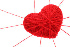Red heart. Made of wool in the web from thread Royalty Free Stock Photography