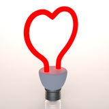 Red heart. Shaped light bulb Stock Images