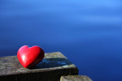 Red heart. Blue Sommer love with red heart Royalty Free Stock Photography
