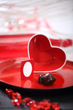 Red heart. Red glass heart on a plate. Photo Frame inside heart Stock Photos