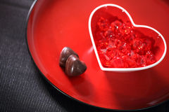 Red heart. Red glass heart on a plate Royalty Free Stock Photo
