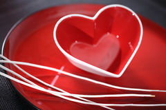 Red heart. Red glass heart on a plate Royalty Free Stock Image