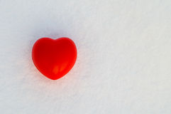 Red heart. On the snow royalty free stock image