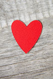 Red heart. Over a wooden background Stock Images
