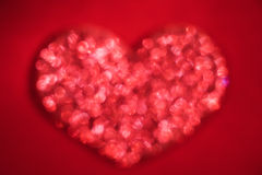 Red heart. With red  defocused light on the red background Stock Photography