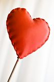 Red heart. Red leather heart on striped white background stock images