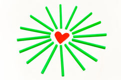 Red Heart. S are in the middle of a small green stick around Royalty Free Stock Image