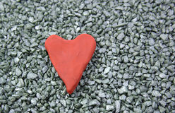 Red heart. Heart red plasticine on a stone background Royalty Free Stock Photo