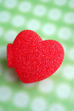 Red heart. On green background royalty free stock photography