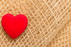 Red heart on abstract cloth background Stock Image