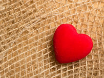 Red heart on abstract cloth background Royalty Free Stock Image