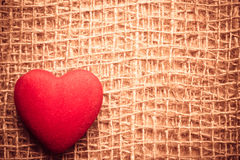Red heart on abstract cloth background Royalty Free Stock Images
