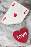 Red heart with ace of hearts in the snow Royalty Free Stock Photography