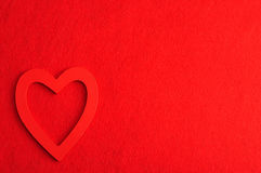 A red heart  against a red background Stock Photos