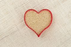 Red Heart of Amaranth on Canvass. Red heart filled with amaranth isolated on a canvass background royalty free stock photos