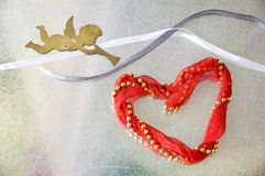 Red heart with angel Stock Images
