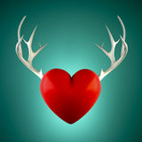 Red heart with antlers on a turquoise background Royalty Free Stock Photography