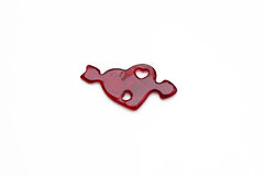 Red heart with arrow made of jelly on a white background. Stock Photo