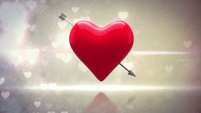 Red heart with an arrow turning on glittering background stock video footage