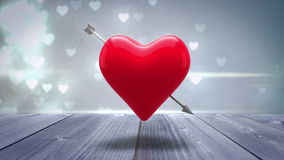 Red heart with an arrow turning on glittering background stock footage