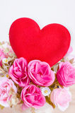 Red heart with artificial rose Royalty Free Stock Images